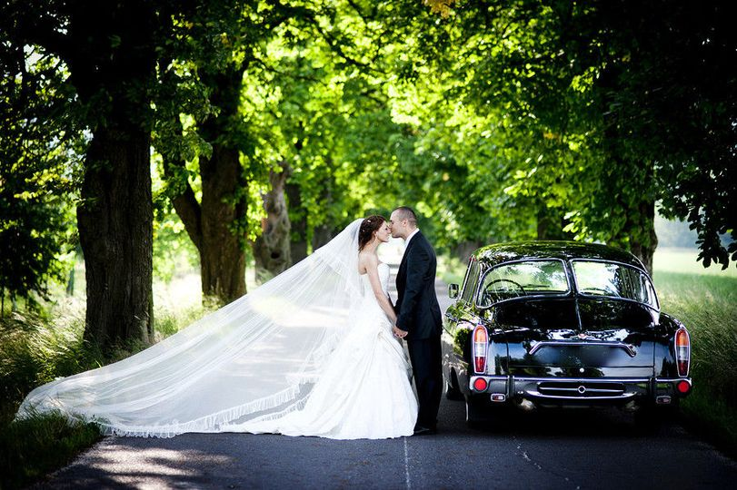 453c76692a66b848 1432046821846 bigstock bride and groom in car 49996160