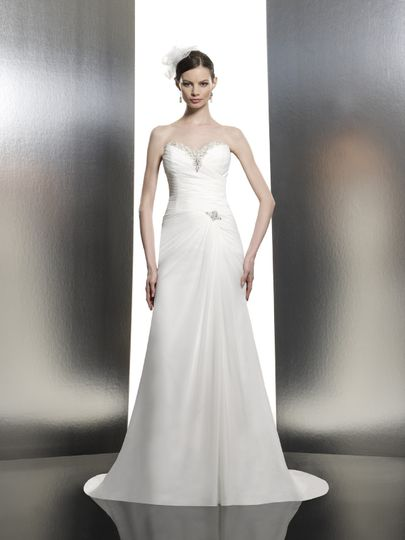 T631  This chiffon trumpet features flattering micro-pleats across the bodice. Swarovski crystals...