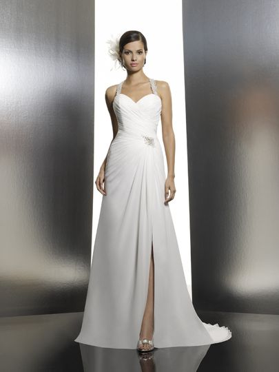 T632  The encrusted halter straps on this sweetheart neckline transforms into a stunning beaded...