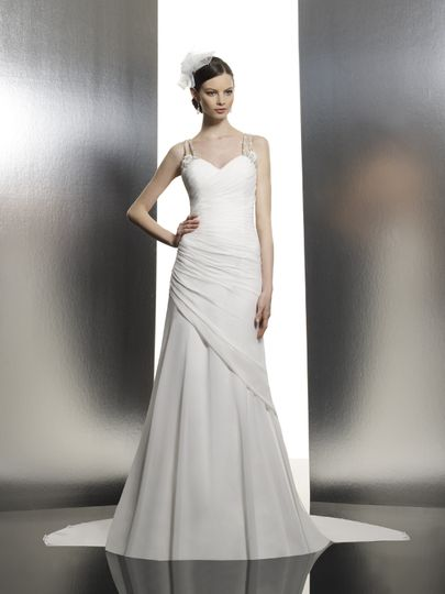 T633  Asymmetrical draping across the body creates a flattering A-line adorned with Swarovski straps...