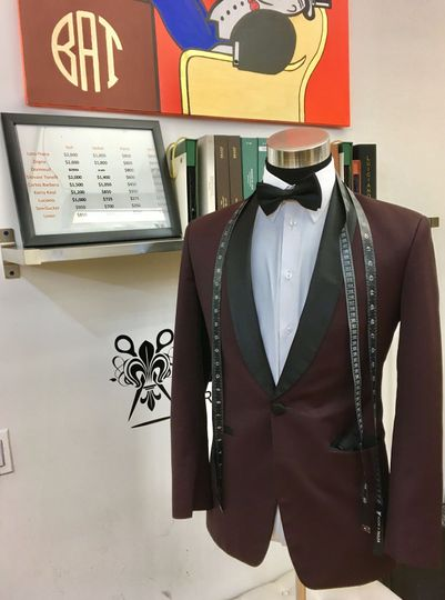 Nice and sleek burgundy tuxedos with classic black bow tie at our NYC showroom