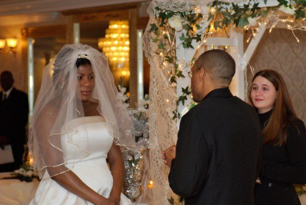 Jennifer stands by while the couple read the emotional vows they wrote for each other.