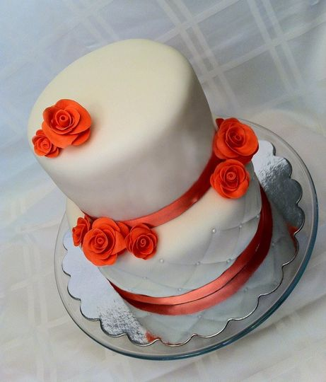 Simple fondant covered cake with handmade fondant coral roses