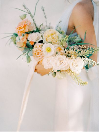 Peach and ivory bridal bouquet with roses and poppies-tied with silk ribbons. Photo: Shannon...