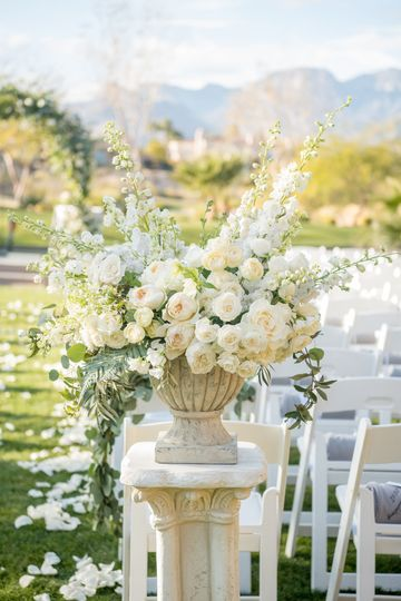 Lush white and ivory ceremony floral arrangement. Photo: KMH Photography