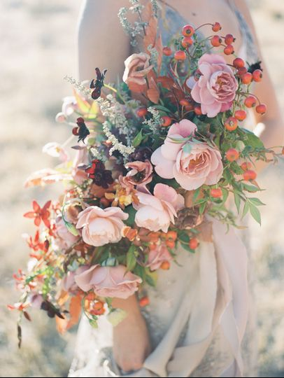 Autumnal bridal bouquet with Distant Drum garden roses, chocolate cosmos, orchids, rose hips and...