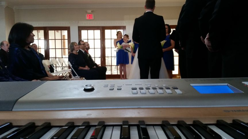 I'd be happy to play live music for you while you walk down the isle, just like in this wedding :)