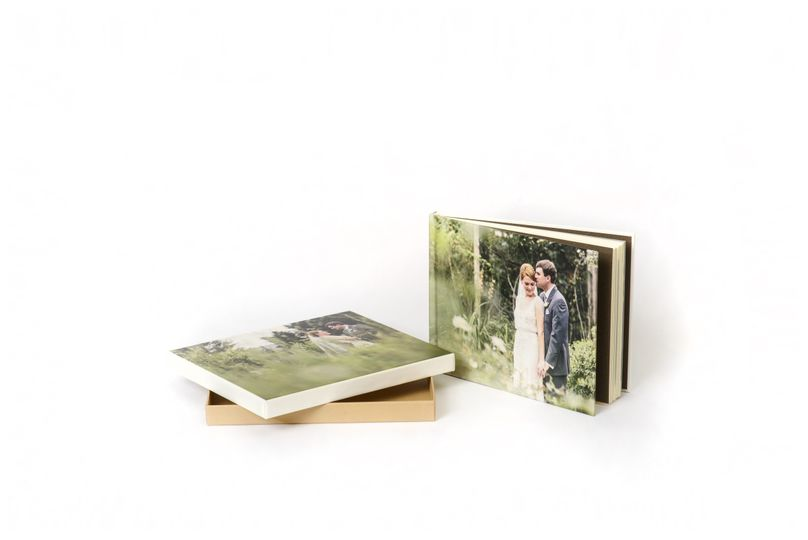 The Art Layflat Book, by AsukaBook, boasts elegant ivory uncoated inside pages with a smooth hard...