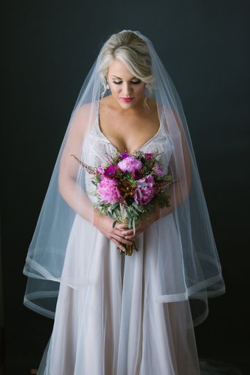 The bride in her veil | Photo Credit: Brittany Conner
