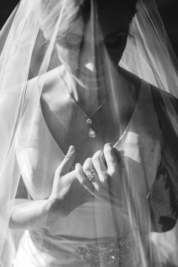 The bride in her veil | Photo Credit: Abigail Malone