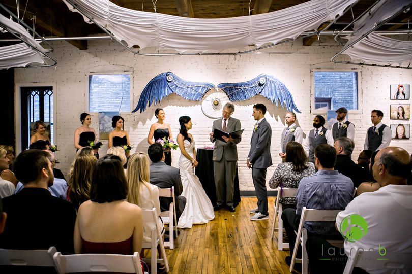 800x800 1459281379029 ceremony with blue wings   laurenbphotography