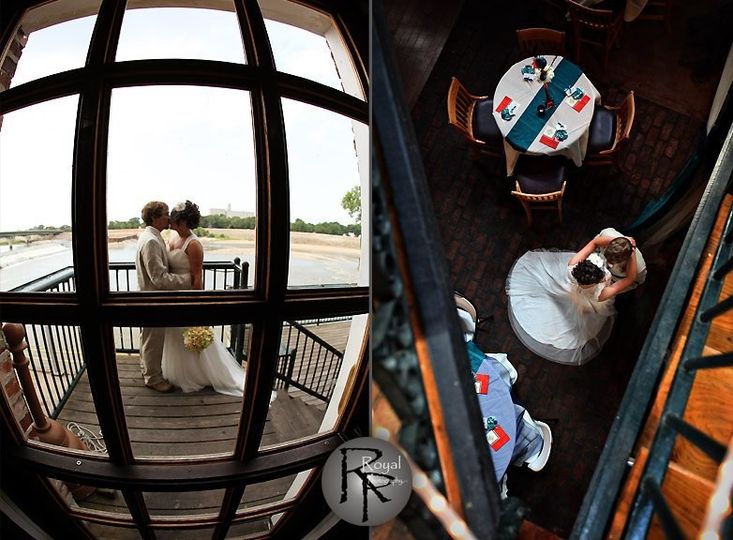 Bride and groom kissing by the staircase