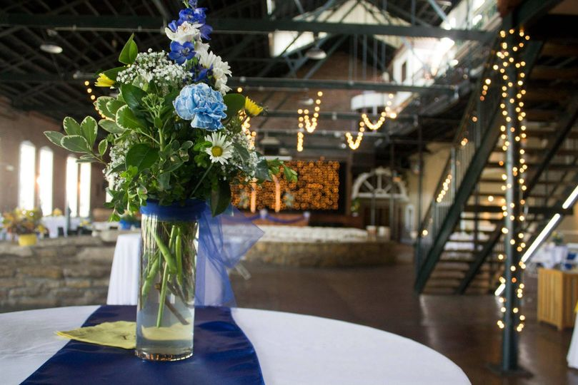 Floral table centerpiece and reception lights
