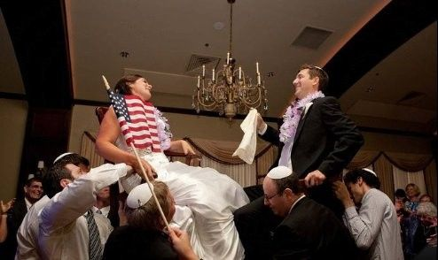 Newlyweds being carried