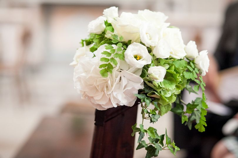 Hydrangeas and roses for the pews