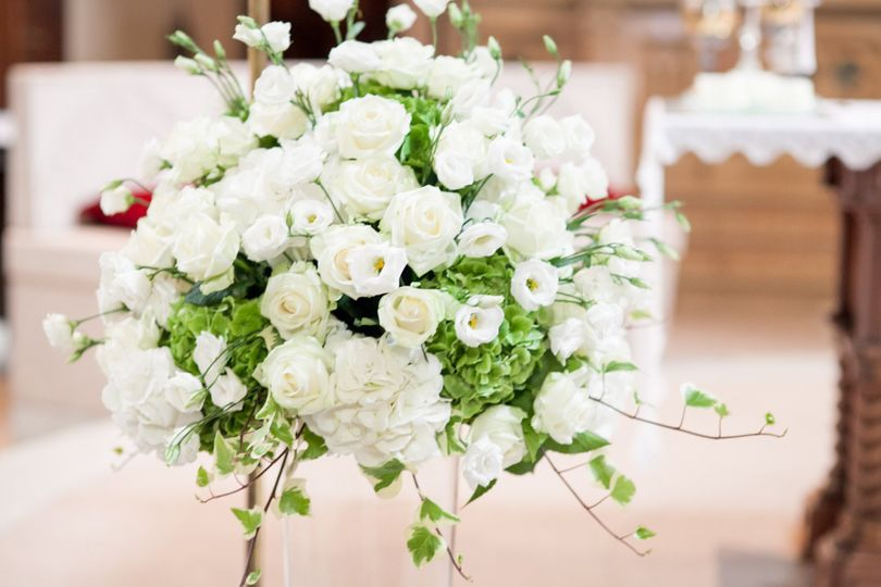 White & green hydrangeas, roses and delphiniums for a church arrangement