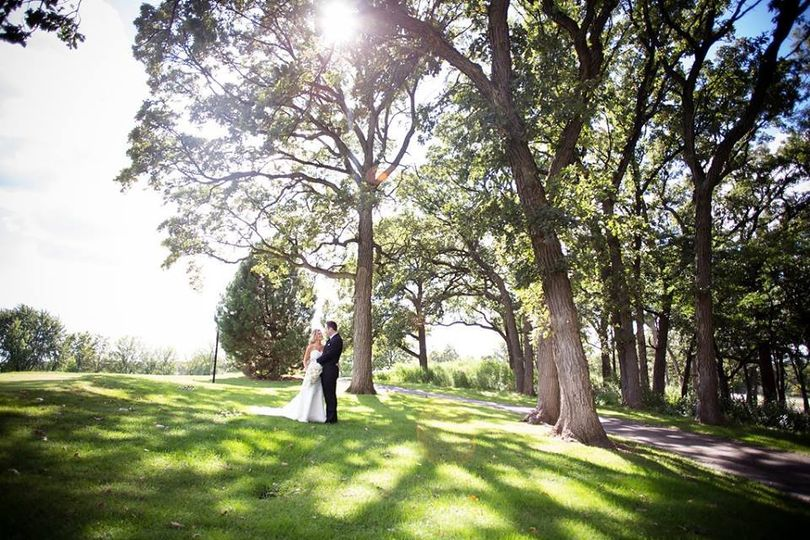 Newlyweds by the trees