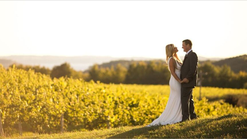 Newlyweds by a field