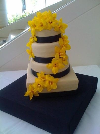 Dairy free wedding cake covered in rolled buttercream and adorned with open tulips