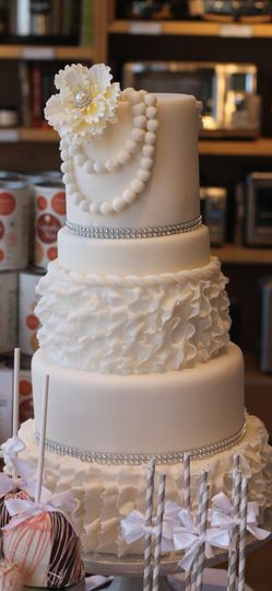Beautiful all white wedding cake designed to match brides dress!