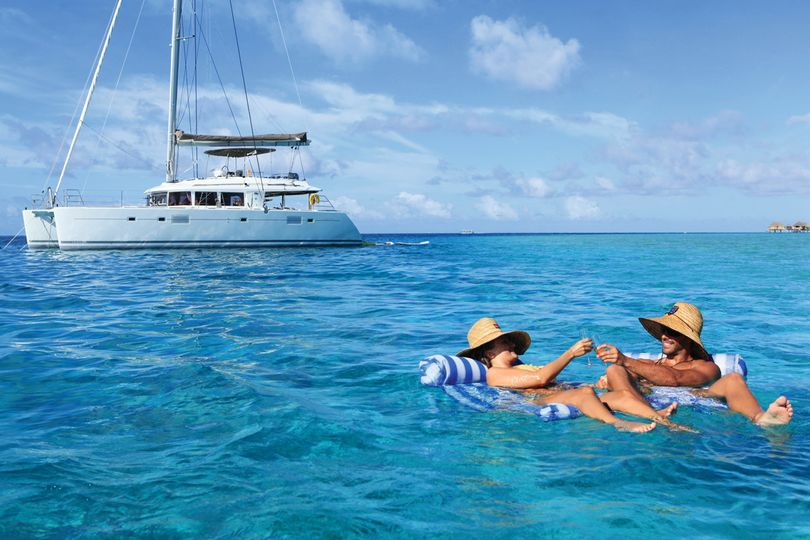 Enjoying the lagoon on a private Tahiti Yacht Charter cruise   Honeymoons by Tahiti.com