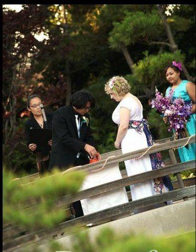 Sake ceremony officiant at Cal State Long Beach Wedding in Earl Burns Miller Japanese Garden....