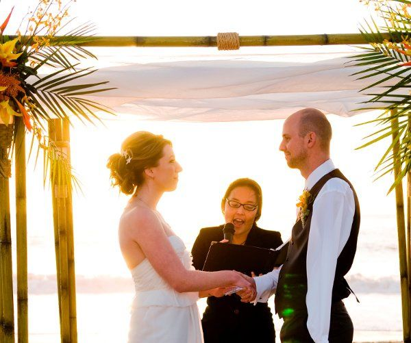 Outdoor wedding officiant at Salt Creek Beach wedding.  Photo by Carolee Cay Beckham (cropped by...