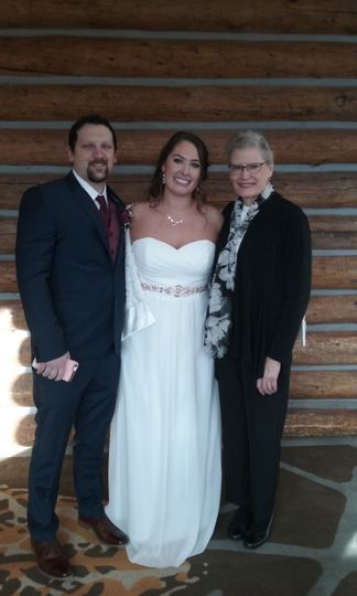 Post wedding photo with the officiant