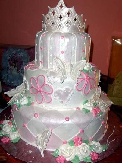 "Fit for a princess and designed with the ""Quince Girl"" in mind, this cake shimmers with pearlescent..."