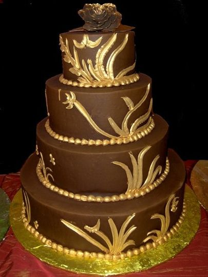 Dark chocolate butter creme with metallic edible gold accents make for an unusual yet elegant...