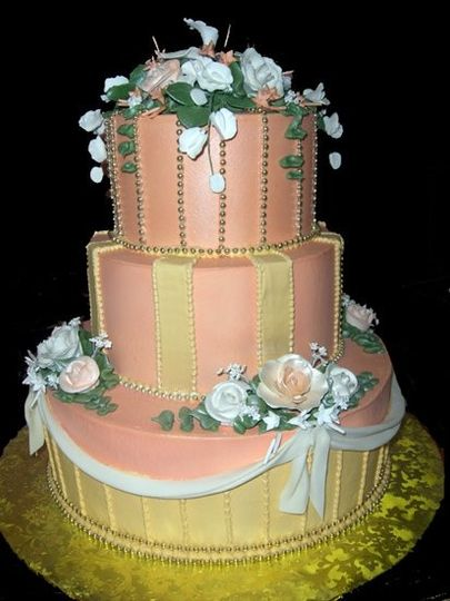 Turn-of-the-Century details add an air of nostaligia to this lovely cake. As always, colors can be...