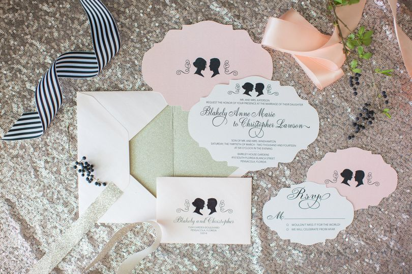 The Silhouette Collection - pearlized invitations in a laser-cut shape to enhance the detailing