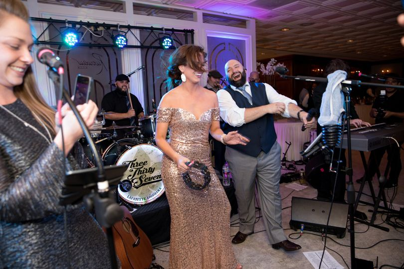 Couple dancing with the band