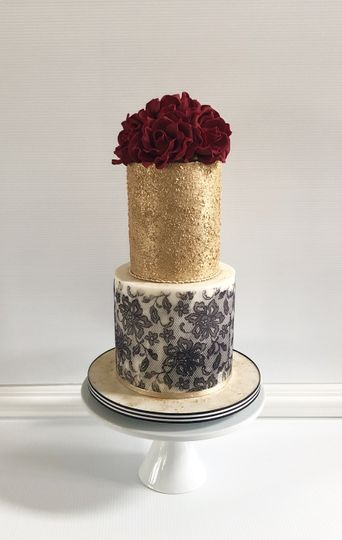 Two tier gold and black cake