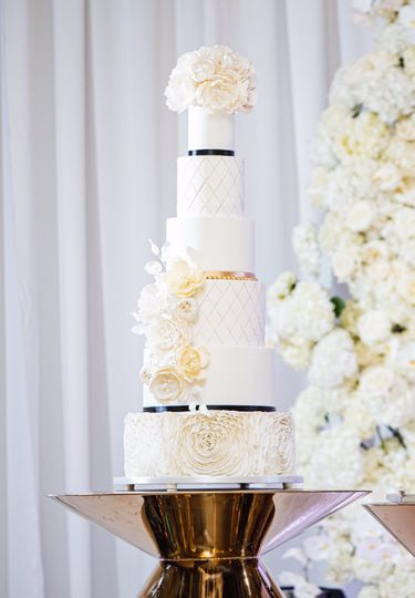 6 tier cake with sugar flowers