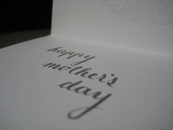 "hand-punched, copperplate-lettered mother's day ""mum"" card on bright white cotton stock"