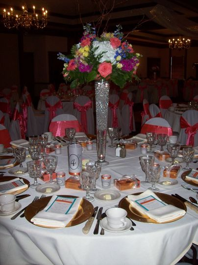 Table setting with tall floral centerpiece