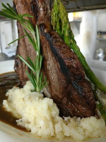 Steak on bed of mashed potatoes