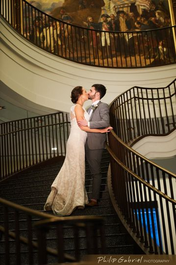 Couple kissing at the staircase