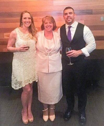 With the newlyweds at the reception