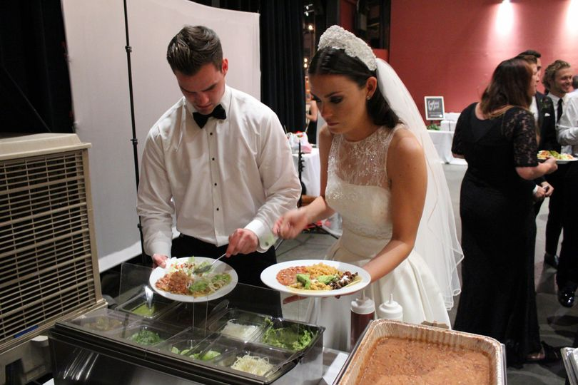 Bride and groom getting food