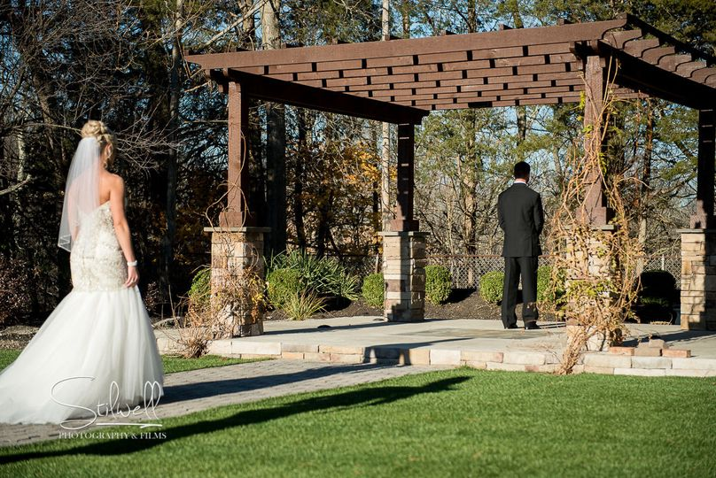 First Look Under Pergola at Villa Borghese Ceremony Site