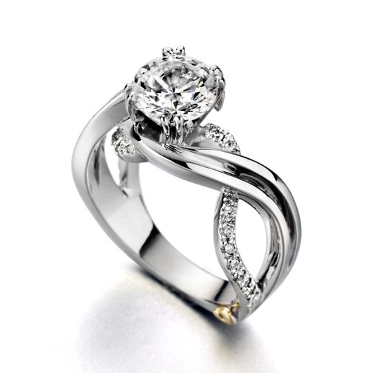 Enchantment - 19535  The Enchantment engagement ring contains 25 diamonds, totaling 0.245 ctw....
