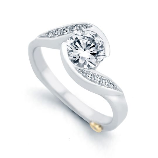 Whirlwind - 17190  The Whirlwind engagement ring contains 11 diamonds, totaling 0.085ctw....
