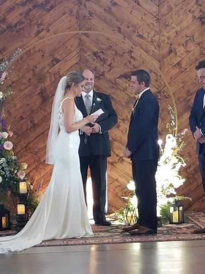 Saying their vows.