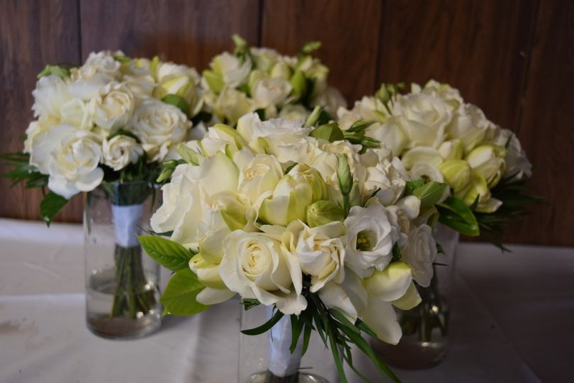 Bridal bouquet with the bridesmaids all white with accents of green.