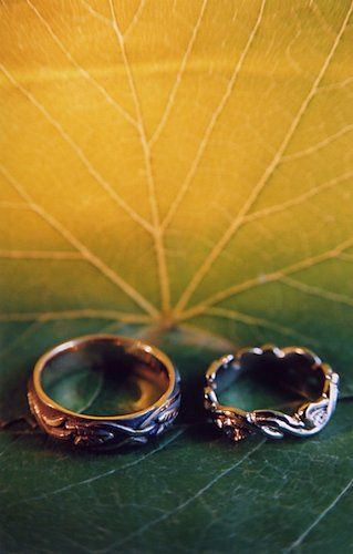 Detail photo of wedding rings on a leaf