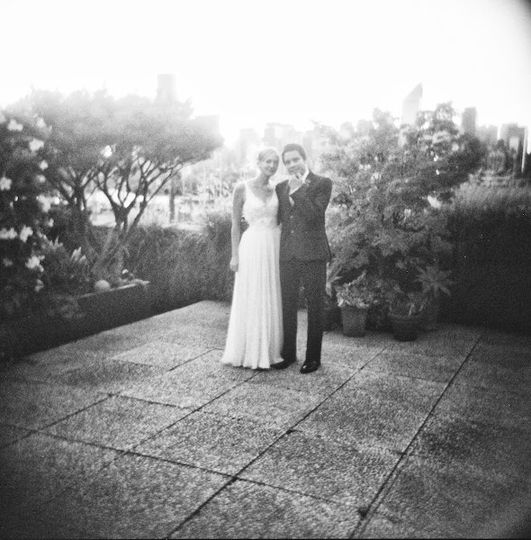 Artistic, black and white film photo of a bride and groom portrait taken with vintage looking camera...