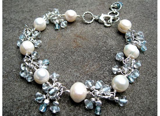 Currently being made for a group of bridesmaids. Freshwater pearls and blue topaz make this a...
