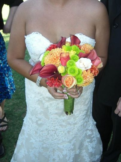 Calla lilies, roses, button mums, coxcomb, dahlias